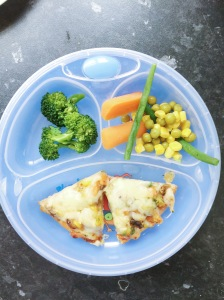 The end result - pizza loaded with vegetables plus finger food veg